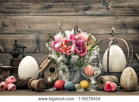 Easter Decoration With Pink Tulips And Colored Eggs