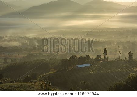 Sunrise at Yoon Lai View Point Smoky fog The village high in the fog Mountain National Park at Pai Mae Hong Son Thailand.