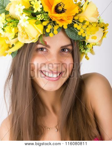 portrait of beautiful girl with floral wreath on her head