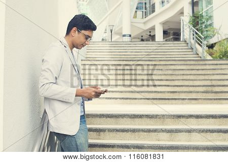Casual Indian Male Using Tablet Outdoor