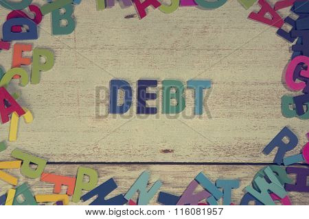 Debt Word Block Concept Photo On Plank Wood