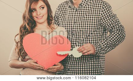 Couple With Paper Key To Heart Love Symbol.