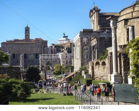 Tourists Visit Italy Via Fori Imperiali In Rome