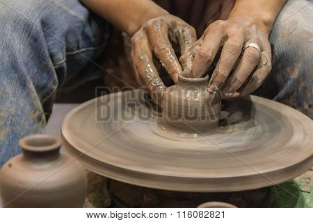 Hands Working On Pottery Wheel, Closeup Retro Style Tone