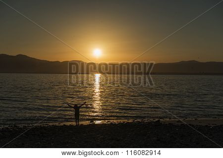 Girl At Sunrise Over The Sea