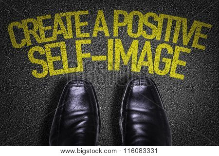 Top View of Business Shoes on the floor with the text: Create a Positive Self-Image