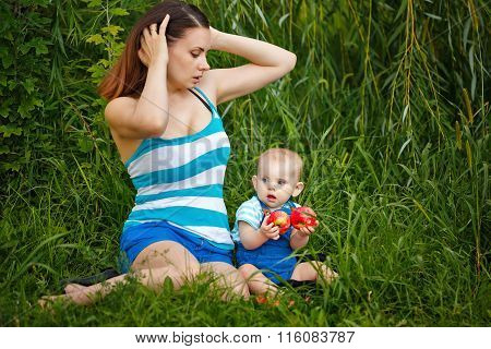 Mother And Daughter Having Picnic.