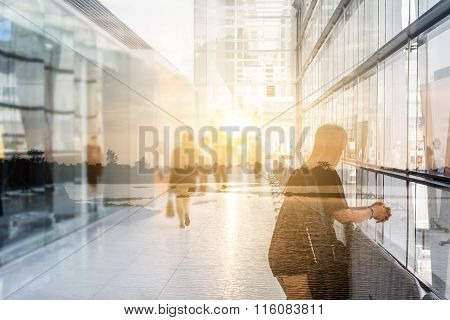 Art Concept : Double Exposure Of Alone Woman In The Lobby In The Rush Hour Of A Modern Business Cent