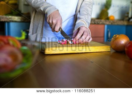 Close-up Of Woman's Hands Cutting Crab Sticks