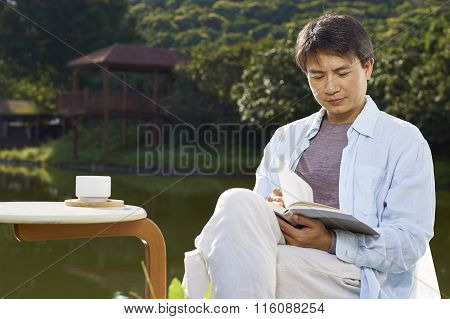 Man Reading Outdoor In Morning