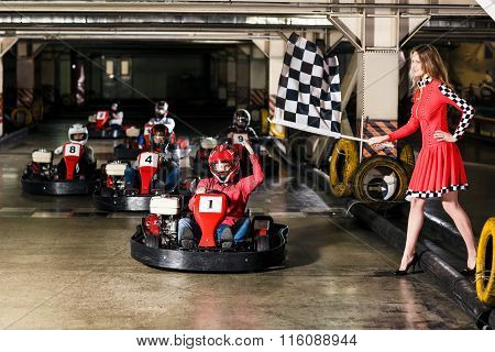 Group of people is driving go-kart car