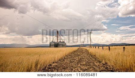 Grain Bins On A Stormy Day