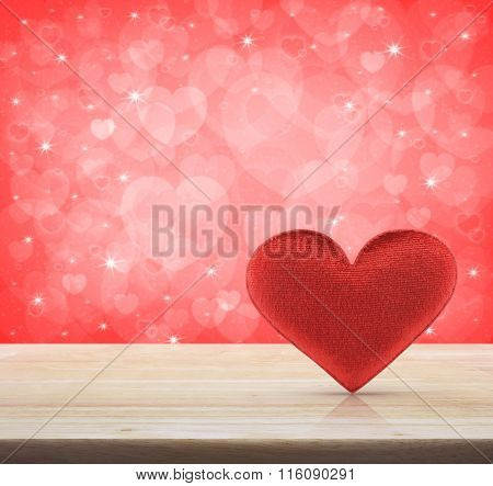 Fabric Red Heart Shape On Wooden Table Over Light Pink Heart Bokeh Background, Valentine Concept