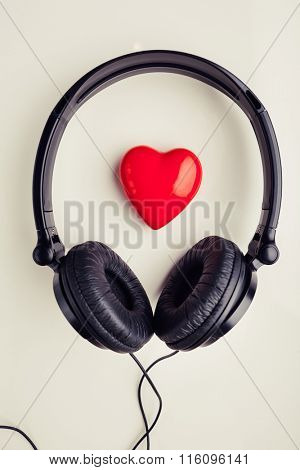 stereo headphones with red heart symbol