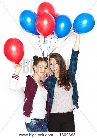 happy teenage girls with helium balloons