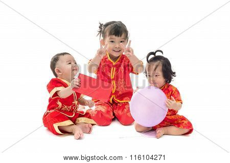 Cute Asian Baby Boy And Girl In Traditional Chinese Suit Isolated On White Background