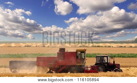 Tractor and combine working in the field