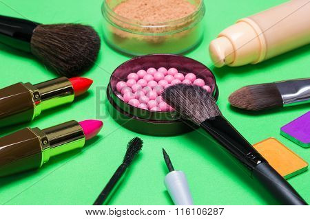 Various Makeup Products On Green Background