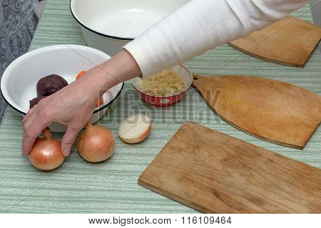 Kitchen Table With Hand Of Woman That Putting Another Bulb.