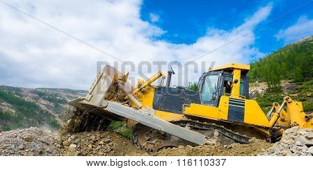 Bulldozer at work at a gold mine