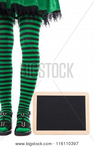Green And Black Striped Legs From A Witch Or Goblin, Slate With Copyspace