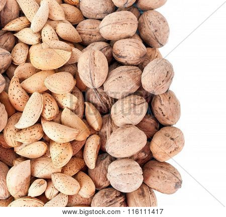 Unpeeled Walnuts and Almonds isolated on white background