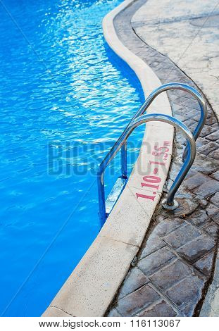 Metal Ladder To Exit From The Swimming Pool