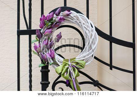 Beautiful Wreath Of Flowers Hanging On Metal Gate