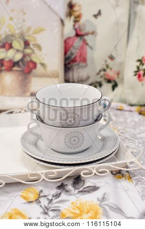 Two Beautiful White Cups And Saucers
