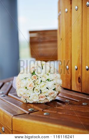 Beautiful Wedding Bouquet Of White Roses Lying On A Bench