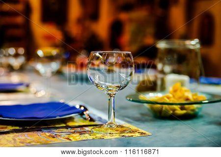 Wineglasses Ready For The Dinner In Little Restaurant