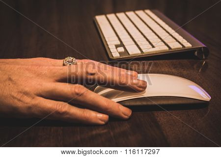 Computer keyboard and mouse in a Hand