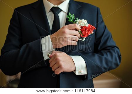 Groom In A Shirt And Tie In The Morning Wears Cufflinks