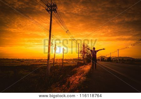 Silhouette Man On The Road With Relax Mood At Sunset.