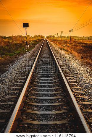 Railway Track In A Rural Scene At Sunrise Time.