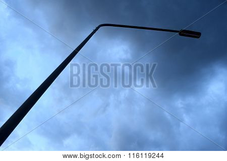 Street Light Poles And Cloudy Storm