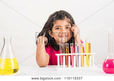 4 year old indian girl doing science experiment,