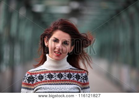 Smiling girl with long hair and pullover