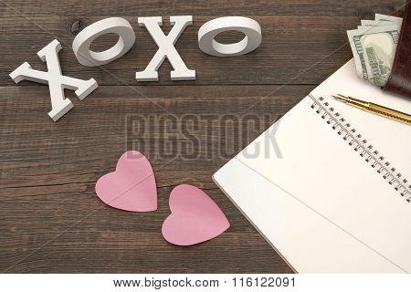 Sign Xoxo, Two Hearts, Pen, Paper, Money On Wood Background