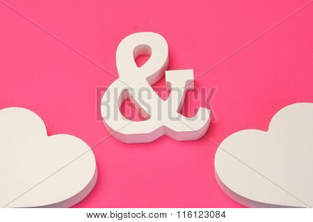 Two White Wooden Heart And  Ampersand Symbol On Pink Background