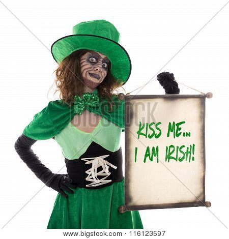 Leprechaun Girl Holding A Scoll With Text Kiss Me I Am Irish, Isolated On White