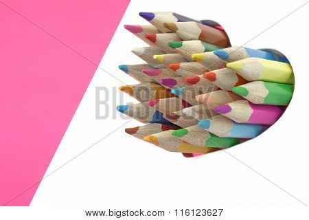Many Color Pencils In The White Wood Heart On Pink  Background. Love Concept.
