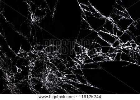 Cracks on the glass against black background