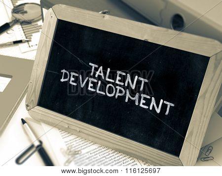 Talent Development Handwritten on Chalkboard.