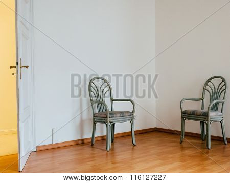 Two Chairs in an empty room