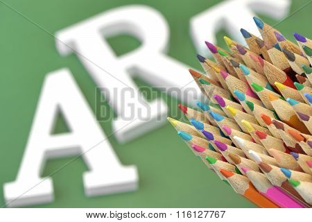 Colored Pencils With Art Sign on Green Background Isolated