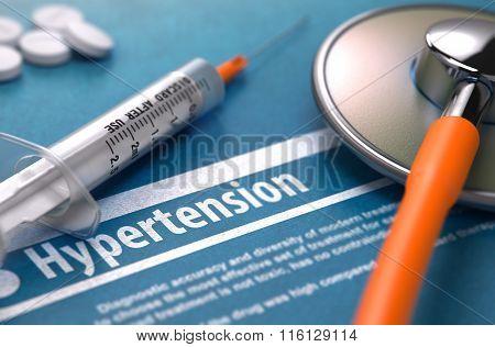 Hypertension. Medical Concept on Blue Background.