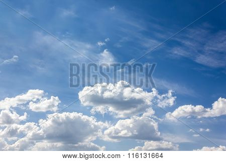 Puffy Clouds On Light Blue Sky