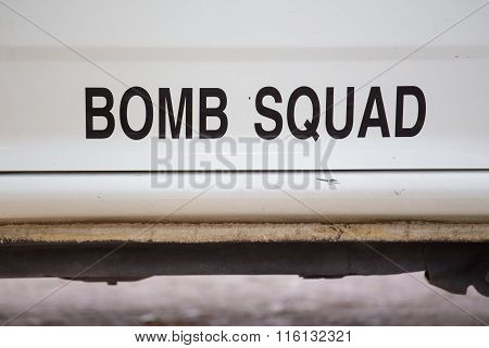 word Bomb squad on team vehicle door