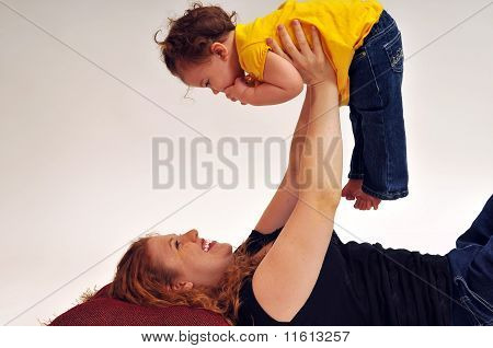 Mother holding baby in the air
